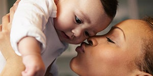mom-kissing-her-happy-baby